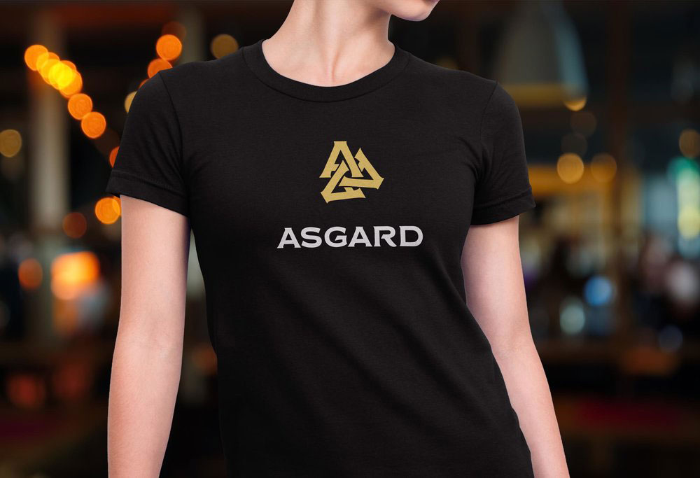 Alternate version of the Asgard logo on a black shirt